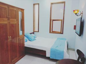 A bed or beds in a room at Khách sạn Nghinh Phong Beach Tuy Hòa