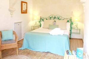 A bed or beds in a room at House with 4 bedrooms in Mao with WiFi 5 km from the beach