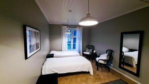 Vuode tai vuoteita majoituspaikassa Dals Inn