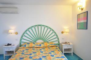Cama ou camas em um quarto em Villa Maria Luigia