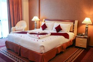 A bed or beds in a room at Elite Grande