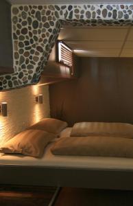 Кровать или кровати в номере Botel Ophoven