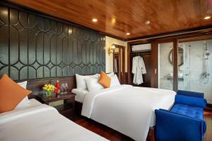 A bed or beds in a room at Ha Long Legend Boutique Cruise
