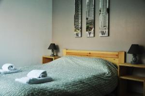 Uma cama ou camas num quarto em Hostel 33