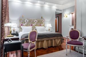 Cama o camas de una habitación en Helvetia Hotel