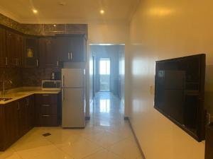A cozinha ou cozinha compacta de Serene Hotel Suites