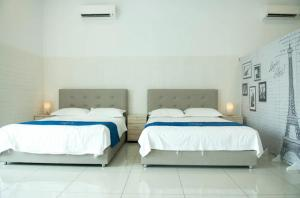 A bed or beds in a room at Austin IKEA-AEON-Toppen by UHA