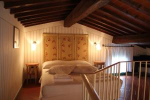 Letto o letti in una camera di Tenuta i Massini