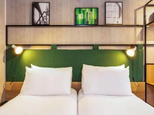 Cama ou camas em um quarto em ibis Paris Bastille Opera