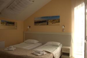 Кровать или кровати в номере Отель Золотая Миля