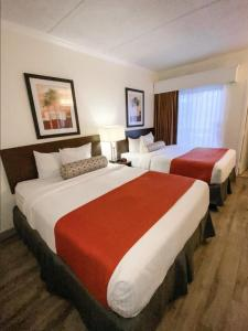 A bed or beds in a room at Karma Nest Tampa