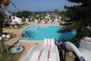Uitzicht op het zwembad bij Hotel Royal Jinene Sousse of in de buurt