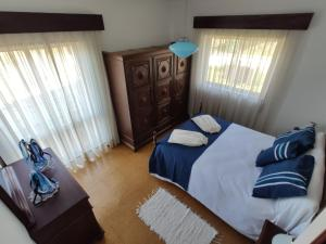 Uma cama ou camas num quarto em Casa do Professor