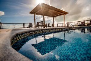 The swimming pool at or close to Porto Suítes Natal Hotel