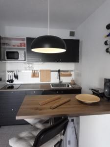 A kitchen or kitchenette at Apartamento SUN Relax en Fuerteventura