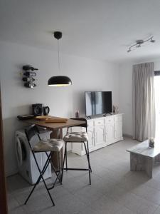 A television and/or entertainment center at Apartamento SUN Relax en Fuerteventura