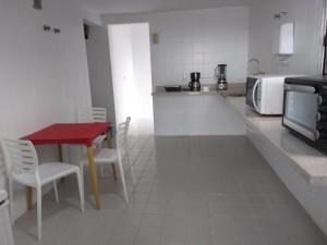 A cozinha ou cozinha compacta de Apto frente mar na praia da Barra
