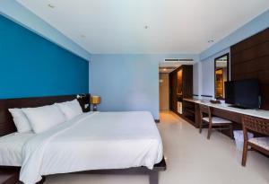 Кровать или кровати в номере Buri Tara Resort