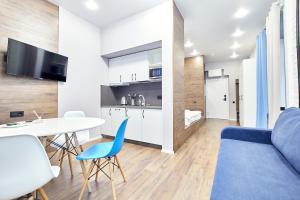 Кухня или мини-кухня в White Apart