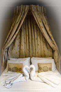 A bed or beds in a room at Pennine Manor Hotel