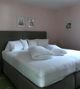 Łóżko lub łóżka w pokoju w obiekcie Appartement Posthäusl