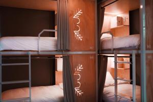 Uma ou mais camas em beliche em um quarto em Casa Pepe