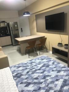 A television and/or entertainment centre at Edificio Time Apto 625