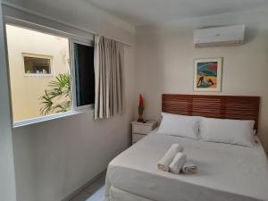 Cama ou camas em um quarto em Flat Solar Água