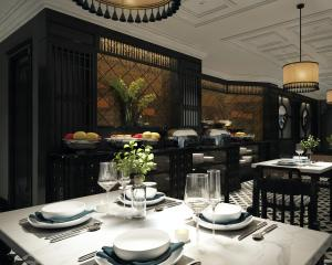 A restaurant or other place to eat at Scent Premium Hotel