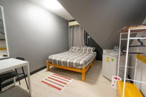 Ein Bett oder Betten in einem Zimmer der Unterkunft Le Plateau Chiangmai
