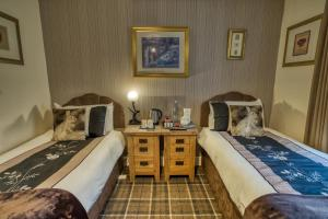 A bed or beds in a room at Pitfaranne Guest House