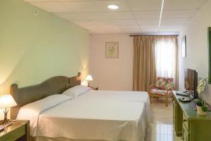 Een bed of bedden in een kamer bij Hotel Marquesa