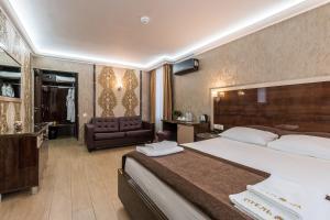Кровать или кровати в номере Отель Эра на Седова