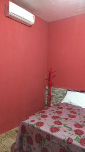 A bed or beds in a room at Pousada e hostel Casa de Laio