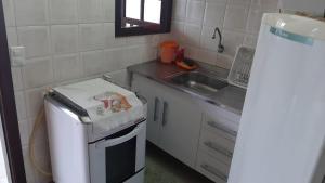 A cozinha ou cozinha compacta de Pousada Nova Opção