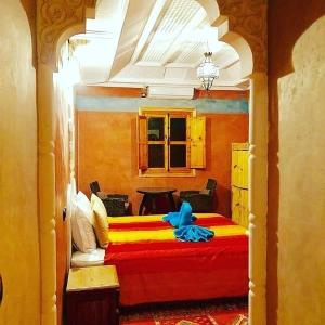 Un ou plusieurs lits dans un hébergement de l'établissement Riad Tourtit