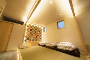 Samurais Villa Nishiooiにあるベッド