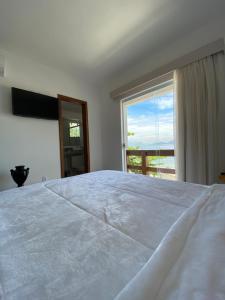 A bed or beds in a room at Pousada Camarote Itaipu