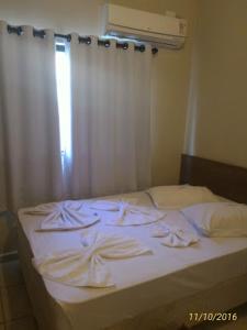 Cama ou camas em um quarto em Aparecida Hotel