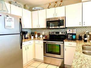 A kitchen or kitchenette at Beach Front 16th Flr, Best Ocean View, New Upgrades