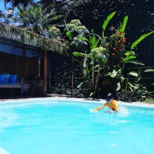 The swimming pool at or close to Pousada Aquarium
