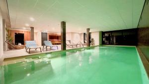 The swimming pool at or near Duinhotel Breezand