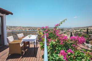 A balcony or terrace at Adamos Hotel Apartments