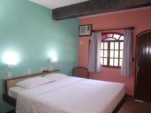 Cama ou camas em um quarto em Pousada Flamingo