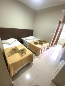 Cama ou camas em um quarto em Hotel San Rafain