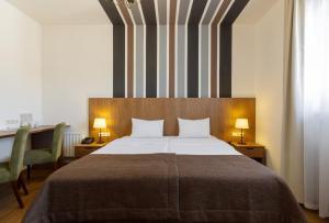Кровать или кровати в номере Rosa Village Hotel Rosa Khutor