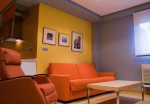 A seating area at Hospedium Cañitas Suites