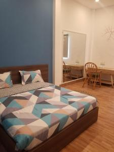 A bed or beds in a room at Ete homestay