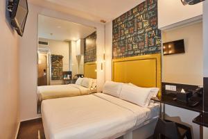 Ein Bett oder Betten in einem Zimmer der Unterkunft Ibis Budget Singapore Bugis (SG Clean)