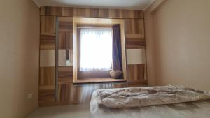 A bed or beds in a room at Gateway Pasteur 2 BR tower depan Jade 11 C